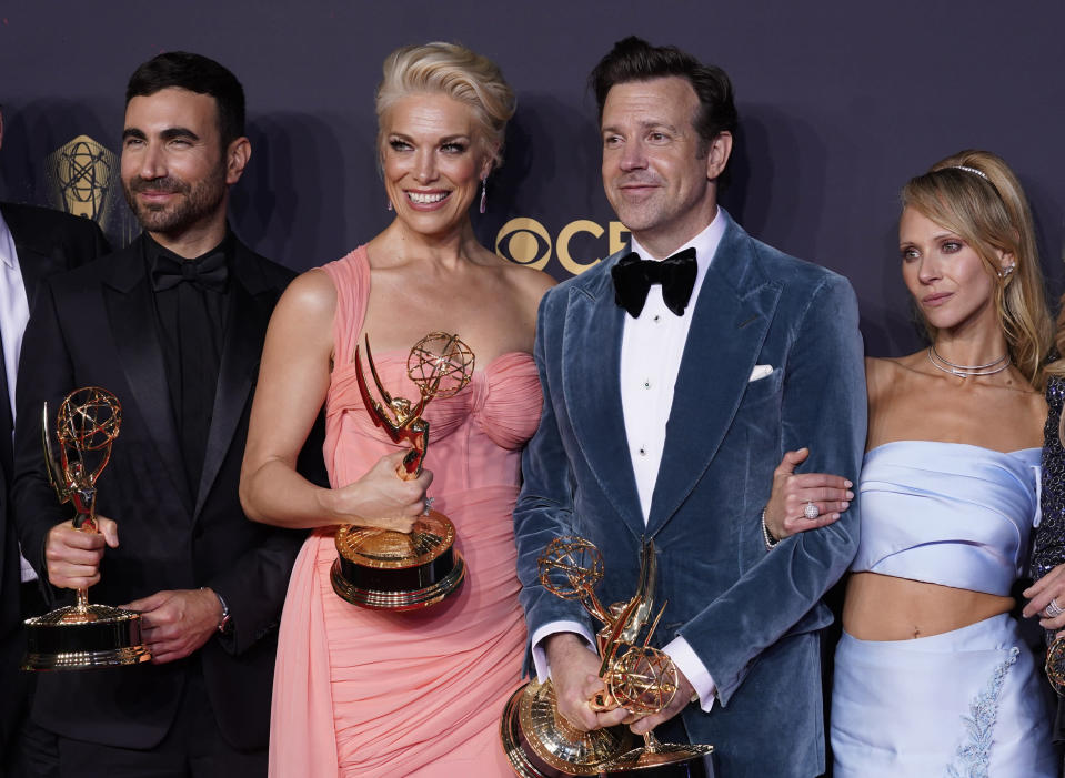 """Brett Goldstein, from left, Hannah Waddingham, Jason Sudeikis and Juno Temple pose with their award for outstanding supporting actor in a comedy series, outstanding supporting actress in a comedy series, outstanding lead actor in a comedy series and outstanding comedy series for """"Ted Lasso"""" at the 73rd Primetime Emmy Awards on Sunday, Sept. 19, 2021, at L.A. Live in Los Angeles. (AP Photo/Chris Pizzello)"""