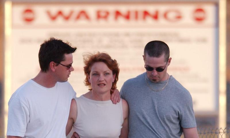 Pauline Hanson with her sons as she was released from prison in 2003 after overturning a fraud conviction. Her One Nation co-founder was jailed at the same time and is looking for recompense for legal fees.