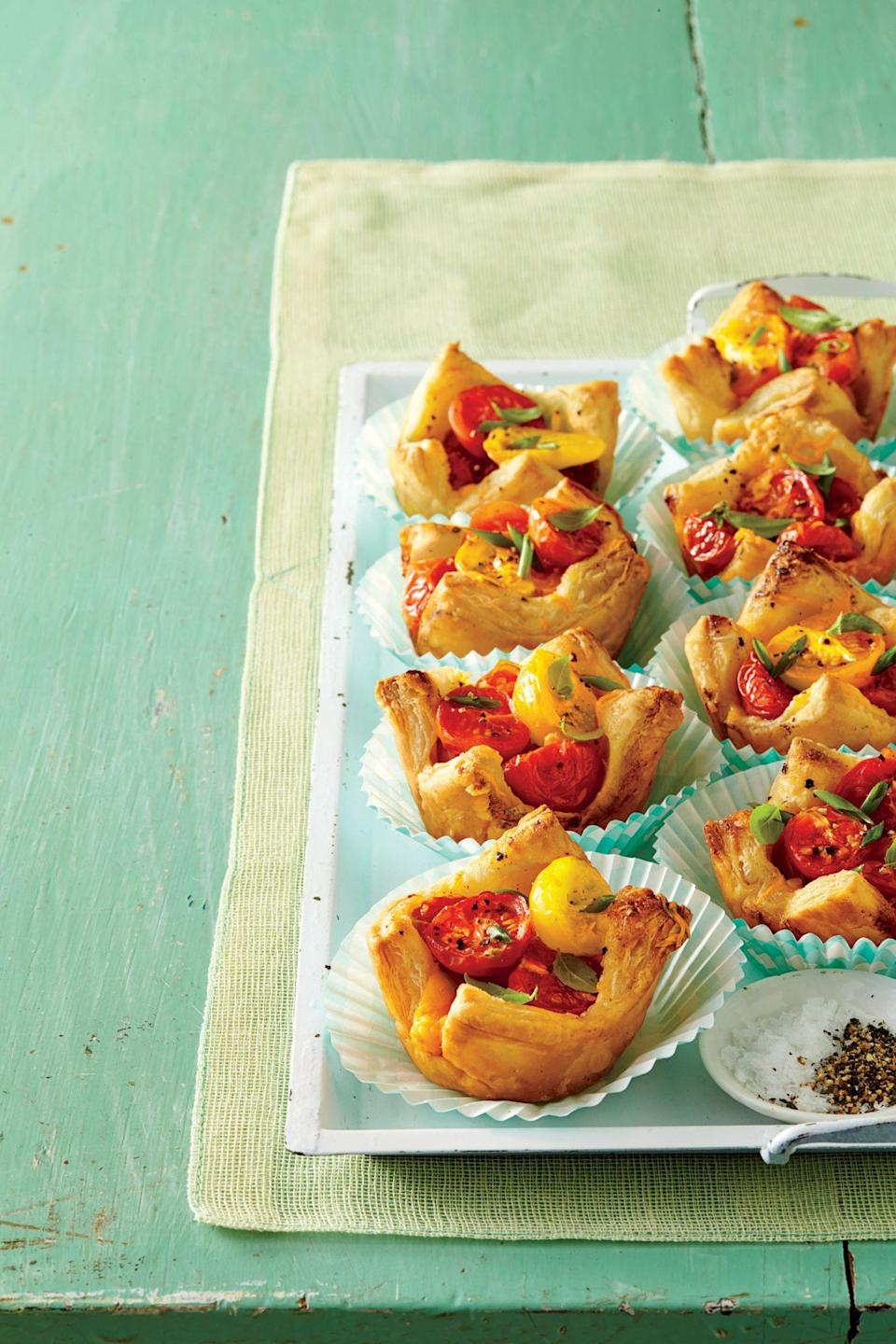 """<p><strong>Recipe: </strong><a href=""""https://www.southernliving.com/syndication/muffin-pan-tomato-tarts"""" rel=""""nofollow noopener"""" target=""""_blank"""" data-ylk=""""slk:Muffin Pan Tomato Tarts"""" class=""""link rapid-noclick-resp""""><strong>Muffin Pan Tomato Tarts</strong></a></p> <p>With this adorable appetizer, family members can each get their own tiny tomato pie.</p>"""