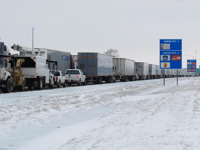Trucks sit in a massive traffic backup on Interstate 55, Tuesday, March 4, 2014 in West Memphis, Ark. (AP Photo/Adrian Sainz)