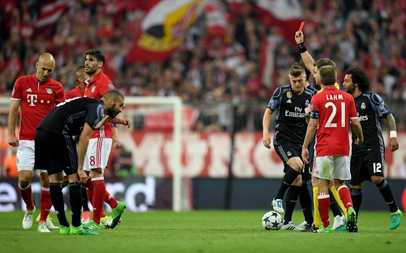 Referee Nicola Rizzoli shows the yellow red card to Javi Martinez - Credit: GETTY