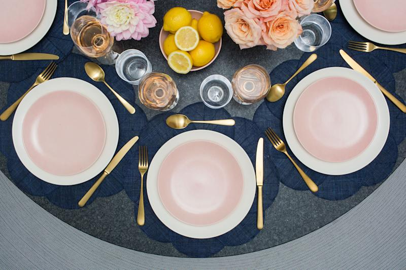 What's on her table: Big Plates in Moon, Small Plates in Daybreak, Small Bowl in Daybreak, Bud Vase in Daybreak , Wine Glasses, Short Glasses, Big Spoon in Matte Gold, Big Fork in Matte Gold, Knife in Matte Gold.
