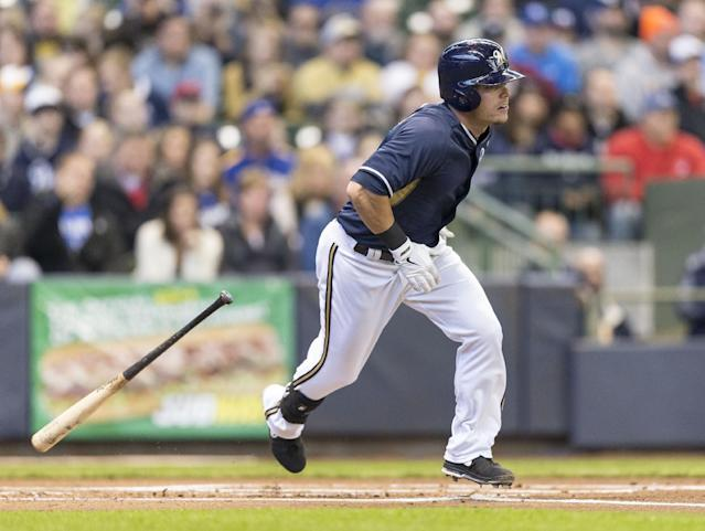 Milwaukee Brewers' Scooter Gennett connects for a single against the Kansas City Royals during the second inning of an exhibition baseball game Saturday, March 29, 2014, in Milwaukee. (AP Photo/Tom Lynn)