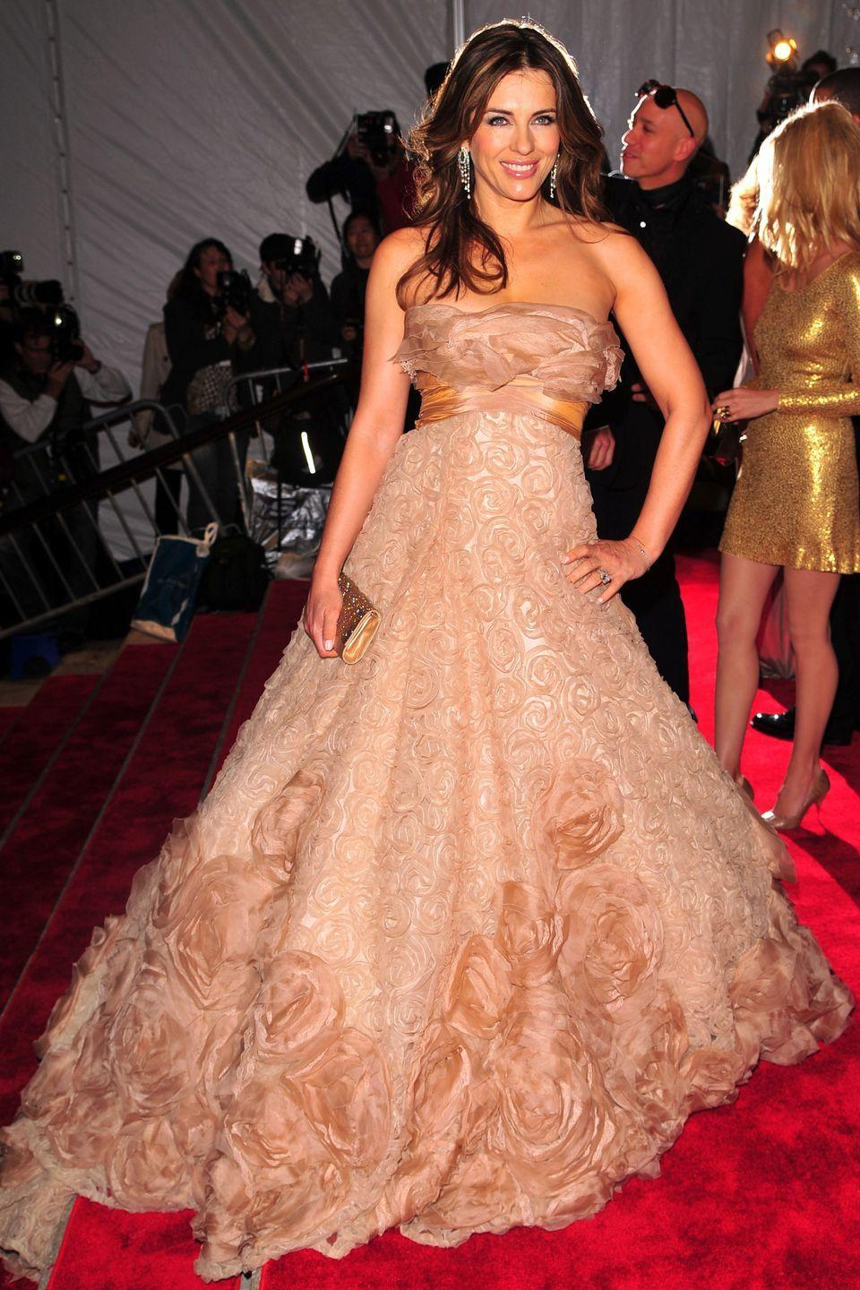 """<p>Elizabeth at another Met Gala, this time dressed in Elie Saab for the """"Model as Muse: Embodying Fashion"""" theme.</p>"""