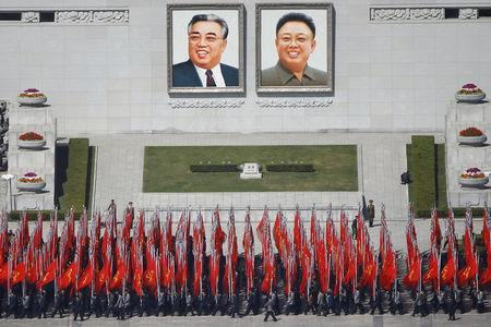 People practice for the expected parade on the main Kim Il Sung square in central Pyongyang