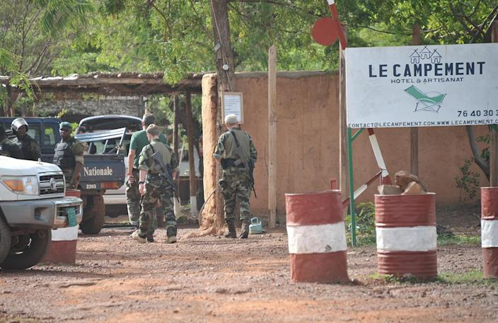 <p>Malian and European forces walk at the entrance of the Kangaba tourist resort on the edge of Bamako on June 19, 2017, a day after suspected jihadists stormed the resort, briefly seizing more than 30 hostages and leaving at least two people dead. (Habibou Kouyate/AFP/Getty Images) </p>