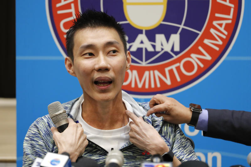 Former world No. 1 badminton player Lee Chong Wei from Malaysia explaining his recent cancer treatment in Taiwan during a press conference in Kuala Lumpur, Malaysia, Thursday, Nov. 8, 2018. Lee explained that he plans to return to the sport and hopes for the Tokyo Olympics if his health allows. (AP Photo/Vincent Thian)