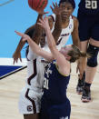 Georgia Tech guard Lotta-Maj Lahtinen (31) shoots against South Carolina forward Laeticia Amihere, left, during the first half of a college basketball game in the Sweet Sixteen round of the women's NCAA tournament at the Alamodome in San Antonio, Sunday, March 28, 2021. (AP Photo/Eric Gay)