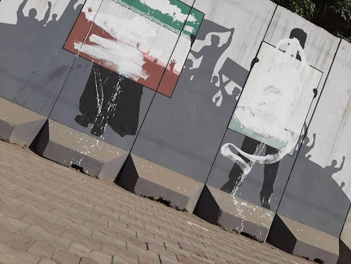Murals on a wall covered in white paint