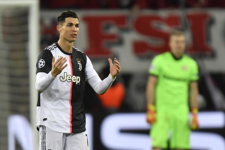 Juventus' Cristiano Ronaldo reacts during the Champions League Group D soccer match between Bayer Leverkusen and Juventus at the BayArena in Leverkusen, Germany, Wednesday, Dec. 11, 2019. (AP Photo/Martin Meissner)