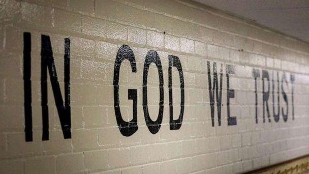 PHOTO: This July 23, 2019 photo shows 'In God We Trust' stenciled in a wall at South Park Elementary in Rapid City, S.D. (Adam Fondren/Rapid City Journal via AP)