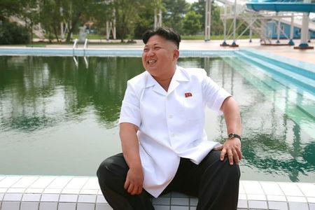 FILE PHOTO: North Korean leader Kim Jong Un gives field guidance during his visit to the Songdowon International Children's Camp in this undated photo released by North Korea's Korean Central News Agency (KCNA) in Pyongyang July 6, 2014. KCNA via REUTERS/File Photo