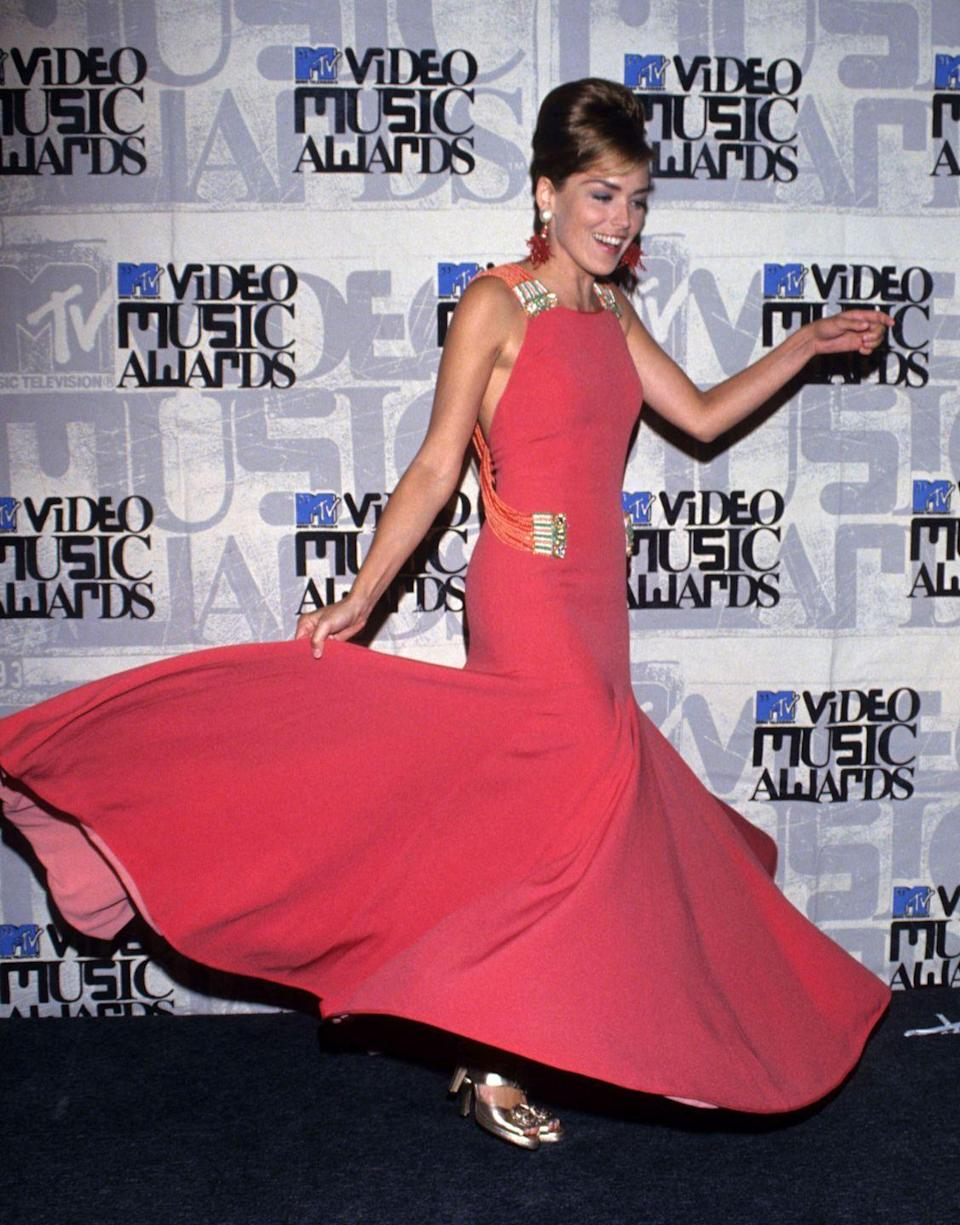 <p>Talk about G-L-A-M, honey. Sharon Stone brought some timeless fashion and fun to the awards in 1993. </p>