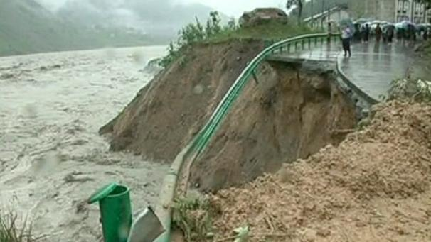 Twelve people have been confirmed dead and at least 11 others are still missing after a landslide in China's southwest Sichuan Province . The landslide was triggered by heavy rainstorms and flooding causing 100,000 cubic metres of earth and stone to pour down the mountain slope. Two people were confirmed dead on the spot. Rescuers found the bodies in the village of Sanxi in Dujiangyan City. In nearby Beichuan Qiang Autonomous County in northern Sichuan, there are concerns that the rising waters of the Tangjiashan Barrier lake are about to flood the homes of more than 700 residents. The Tangjiashan Barrier Lake was formed in the 2008 Sichuan Earthquake, by a landslide that blocked a local river channel. In Qianfo Town, close to Beichuan, a rescue team dispatched by the military saved more than 110 villagers who were trapped by the flood. Rescue work to find survivors continues. Firefighters and police officers are carrying out searches for survivors by using life detectors, 30 bulldozers and 10 excavators. Ambulances are standing by.