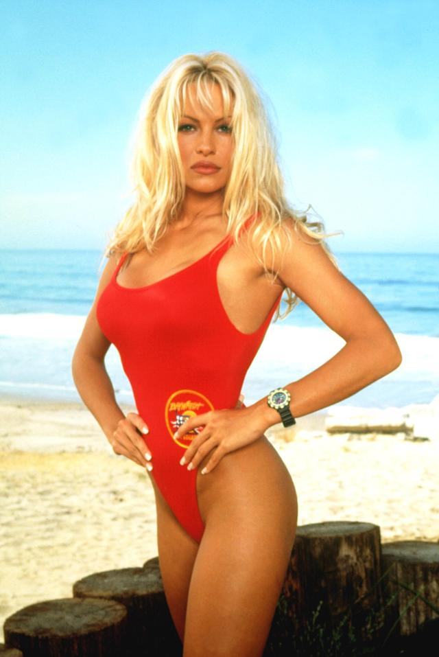 Pamela Anderson in her <em>Baywatch</em> one-piece. (Photo: Everett Collection)