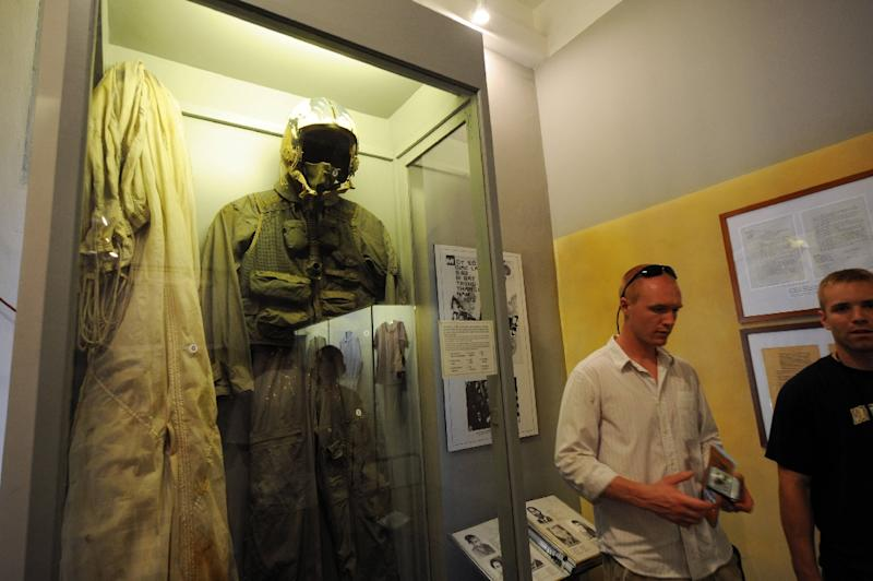John McCain's flight suit is displayed at the 'Hanoi Hilton', now a museum in the Vietnamese capital (AFP Photo/HOANG DINH Nam)