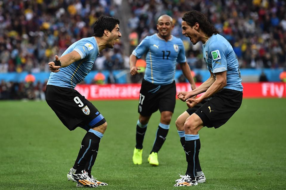 Uruguay strikers Luis Suarez and Edinson Cavani celebrate during a group stage win over England at the 2014 World Cup. Their group is much easier this time around. (Getty)