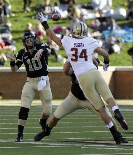 Wake Forest's Tanner Price (10) throws a pass under pressure from Boston College's Sean Duggan (34) during the first half of an NCAA college football game in Winston-Salem, N.C., Saturday, Nov. 3, 2012. (AP Photo/Chuck Burton)