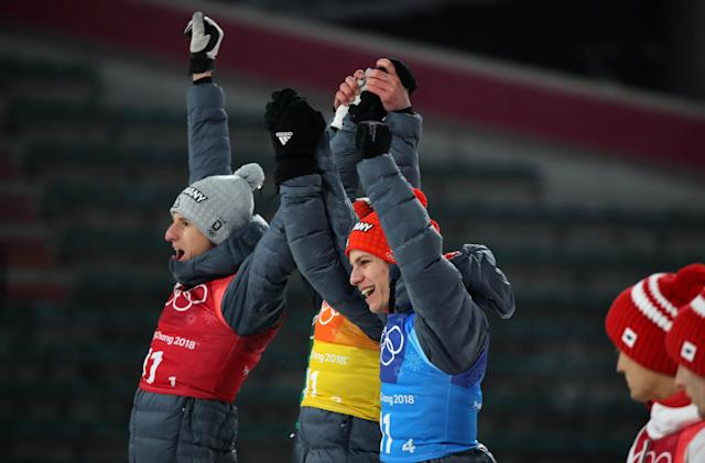 Ski Jumping - Pyeongchang 2018 Winter Olympics - Men's Team Final - Alpensia Ski Jumping Centre - Pyeongchang, South Korea - February 19, 2018 - Silver medalists Karl Geiger, Stephan Leyhe, Richard Freitag and Andreas Wellinger of Germany celebrate during the victory ceremony. REUTERS/Carlos Barria