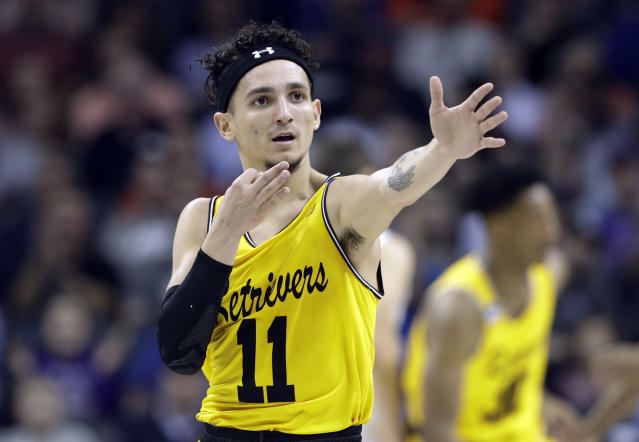 UMBC's K.J. Maura (11) celebrates after a basket against Virginia during the first half of a first-round game in the NCAA men's college basketball tournament in Charlotte, N.C., Friday, March 16, 2018. (AP Photo/Gerry Broome)