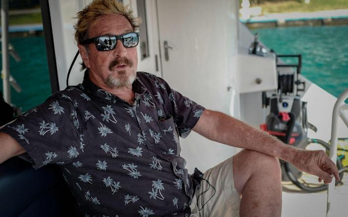 Millionaire John McAfee gesturing during an interview with AFP on his yacht anchored at the Marina Hemingway in Havana - AFP
