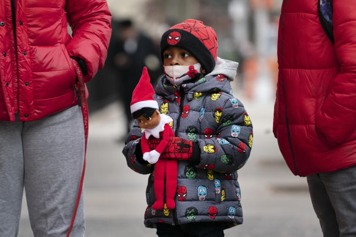 Jayceon Melendez arrives at P.S. 134 Henrietta Szold Elementary School, Monday, Dec. 7, 2020, in New York. Public schools reopened for in-school learning Monday after being closed since mid-November. (AP Photo/Mark Lennihan)