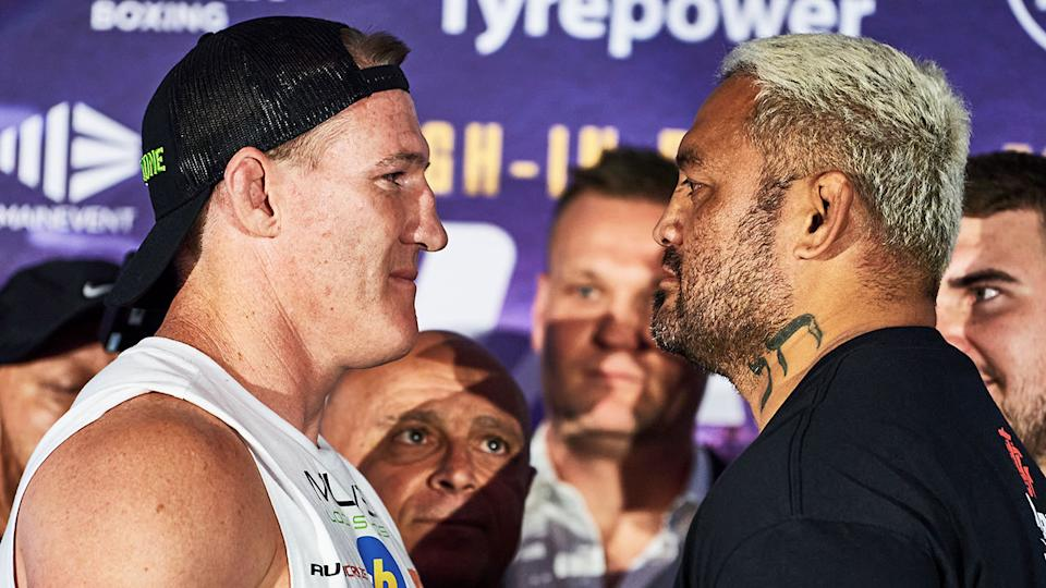 Paul Gallen and Mark Hunt are seen here staring one another down at weigh-in.