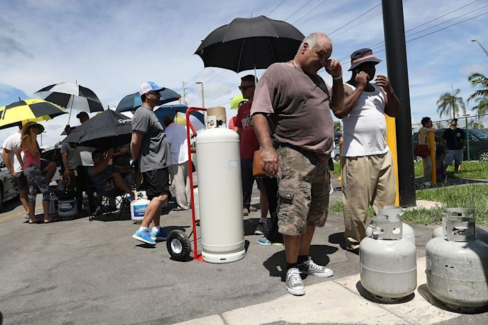 People line up to get their propane tanks filled as they prepare for Hurricane Irma in Miami.