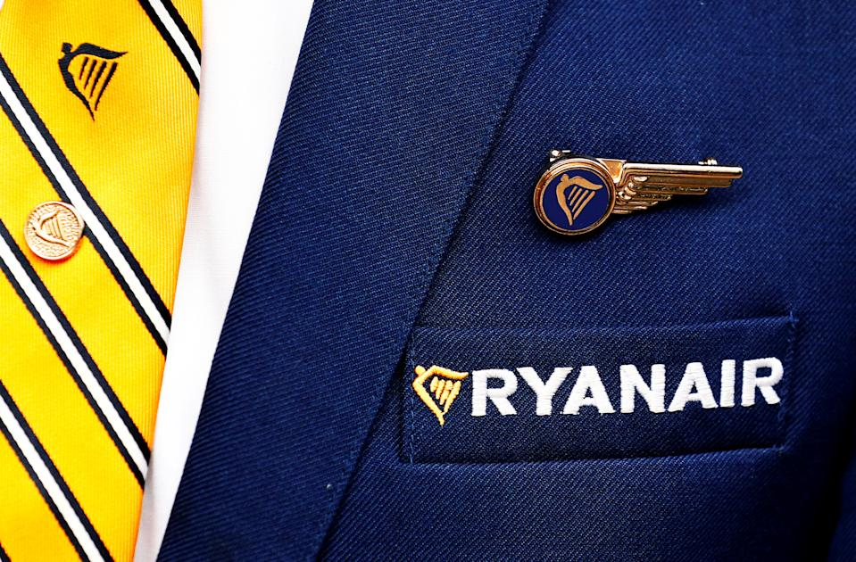 Ryanair logo is pictured on the the jacket of a cabin crew member ahead of a news conference by Ryanair union representatives in Brussels, Belgium September 13, 2018. Photo: REUTERS/Francois Lenoir