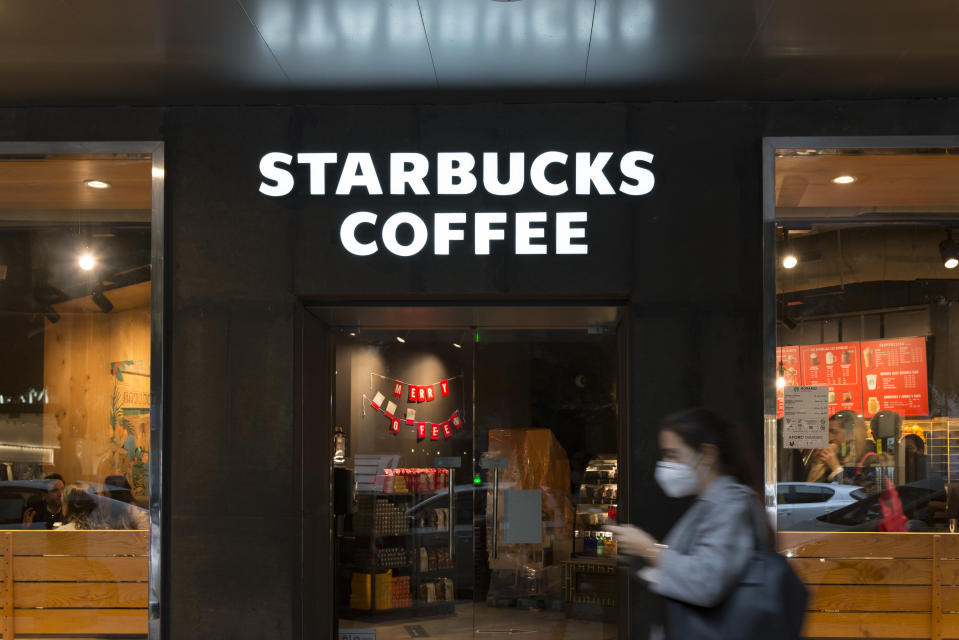 Starbucks Coffee shop seen with Black Friday stickers during the heavy rain. (Photo by Xisco Navarro/SOPA Images/LightRocket via Getty Images)