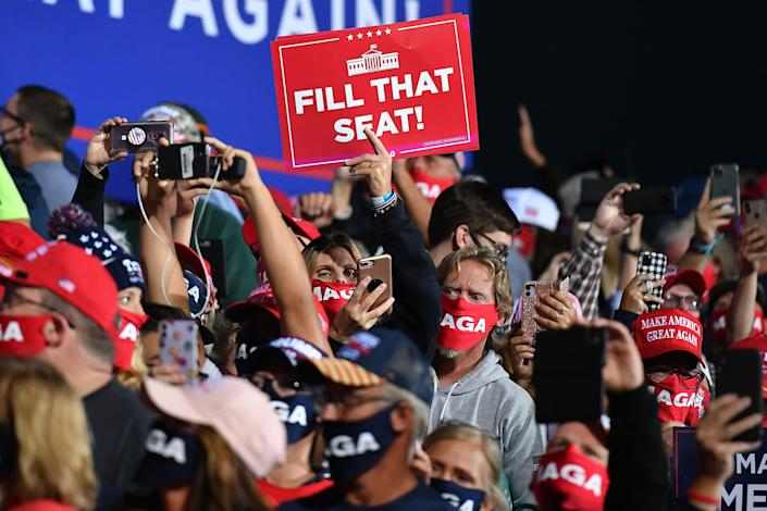 """Supporters of President Trump attend a rally at Toledo Express Airport in Swanton, Ohio on Sept. 21, 2020. <span class=""""copyright"""">Mandel Ngan—AFP/Getty Images</span>"""