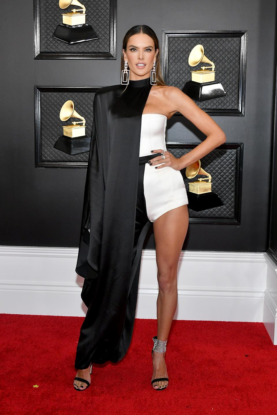 The Brazilian supermodel wore an outfit that could only be pulled off by a Brazilian supermodel! Ambrosio hit the red carpet in a caped monochrome look by Balmain.