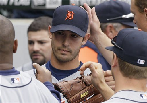 Detroit Tigers starter Rick Porcello celebrates with teammates in the dugout during the eighth inning of a baseball game against the Chicago White Sox in Chicago, Sunday, April 15, 2012. The Tigers won 5-2. (AP Photo/Nam Y. Huh)