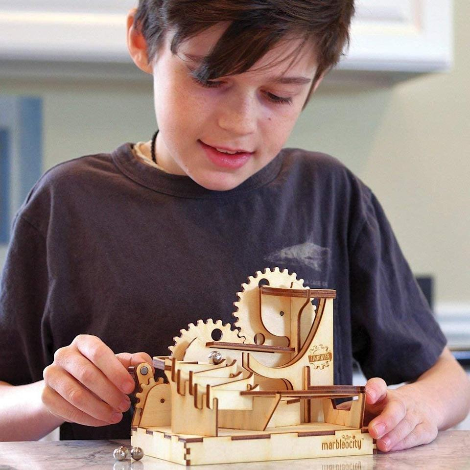 """<p>Kids get to tinker in the best possible way with a <a href=""""https://www.popsugar.com/buy/Build-Your-Marble-Coster-330048?p_name=Build%20Your%20Marble%20Coster&retailer=amazon.com&pid=330048&price=22&evar1=moms%3Aus&evar9=25997679&evar98=https%3A%2F%2Fwww.popsugar.com%2Fphoto-gallery%2F25997679%2Fimage%2F43966685%2FBuild-Your-Own-Marble-Coster&list1=holiday%2Cgift%20guide%2Ckid%20shopping%2Choliday%20living%2Choliday%20for%20kids&prop13=api&pdata=1"""" class=""""link rapid-noclick-resp"""" rel=""""nofollow noopener"""" target=""""_blank"""" data-ylk=""""slk:Build Your Marble Coster"""">Build Your Marble Coster</a> ($22) that lets them build their own toy from scratch. </p>"""