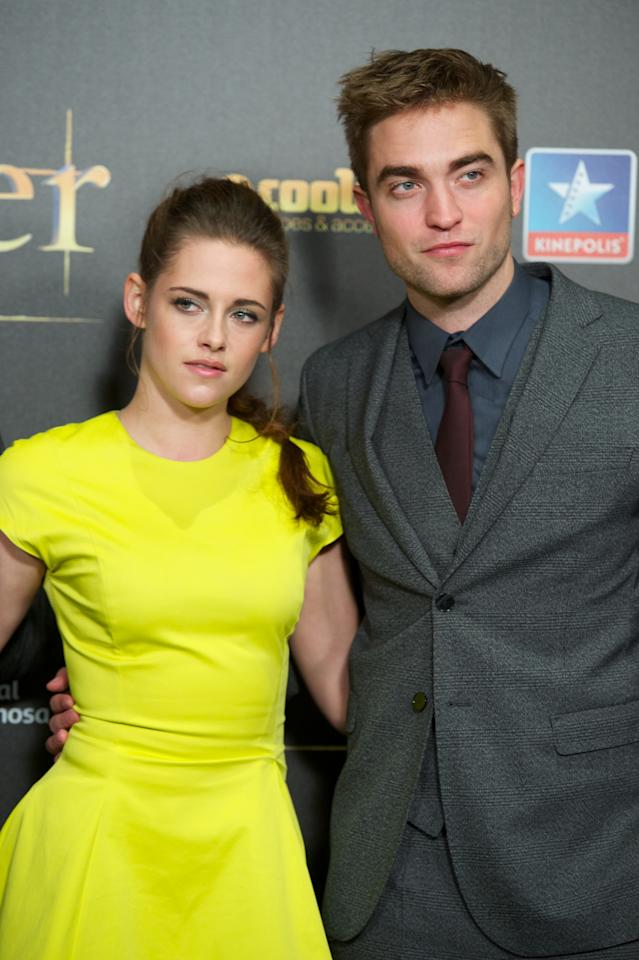 "MADRID, SPAIN - NOVEMBER 15:  Actress Kristen Stewart and actor Robert Pattinson attend the ""The Twilight Saga: Breaking Dawn - Part 2"" (La Saga Crepusculo: Amanecer Parte 2) premiere at the Kinepolis cinema on November 15, 2012 in Madrid, Spain.  (Photo by Carlos Alvarez/Getty Images)"