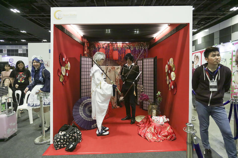 <p>A pair of cosplayers posing in a photo decorated booth at the Asia Game Festival 2018. (PHOTO: Don Wong) </p>
