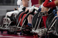 The wheelchairs of U.S. team members are seen during their Wheelchair Rugby pool match match against Canada at the Tokyo 2020 Paralympic Games, Thursday, Aug. 26, 2021, in Tokyo, Japan. There are 4,403 Paralympic athletes competing in Tokyo, each with unique differences that have to be classified. Lines have to be draw, in the quest for fairness, to group similar impairments, or impairments that yield similar results. (AP Photo/Shuji Kajiyama)