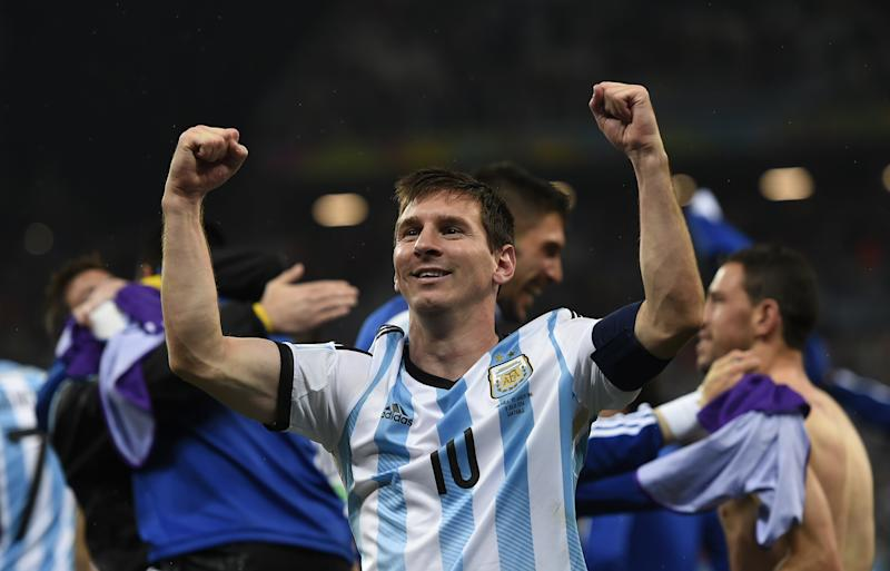 Argentina's forward and captain Lionel Messi celebrates after winning their semi-final match against the Netherlands in a penalty shoot-out following extra time at The Corinthians Arena in Sao Paulo on July 9, 2014