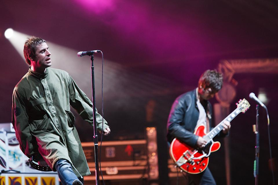 GRAEFENHAINICHEN, GERMANY - JULY 19:  Musicians Liam Gallagher (L) and Noel Gallagher of Oasis perform live at the Melt! Festival in Ferropolis on July 19, 2009 in Graefenhainichen, Germany.  (Photo by Marco Prosch/Getty Images)