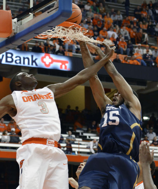 Ryerson's Kadeem Green, right, dunks against Syracuse's Jerami Grant during the first half of a men's NCAA college exhibition basketball game in Syracuse, N.Y., Tuesday, Nov. 5, 2013. (AP Photo/Kevin Rivoli)