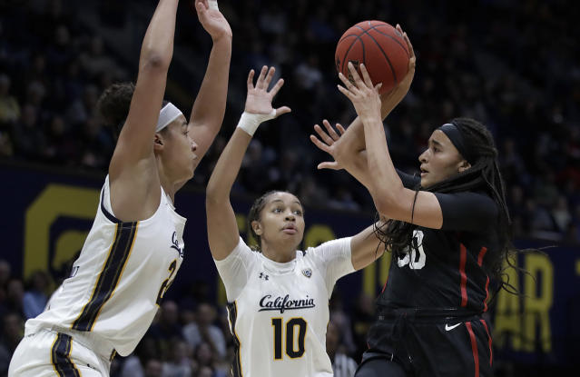 Stanford's Haley Jones, right, looks to pass away from California's Evelien Lutje Schipholt, left, and Jazlen Green (10) in the first half of an NCAA college basketball game Sunday, Jan. 12, 2020, in Berkeley, Calif. (AP Photo/Ben Margot)