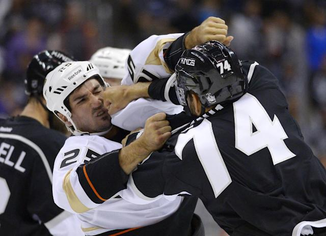 Los Angeles Kings center Dwight King, right, and Anaheim Ducks right wing Brad Staubitz fight during the first period of an NHL preseason hockey game, Tuesday, Sept. 24, 2013, in Los Angeles. (AP Photo/Mark J. Terrill)