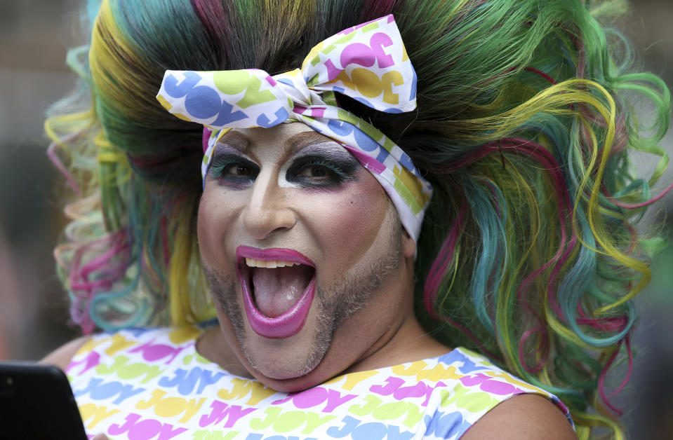 A participant smiles as he prepares for the annual Gay and Lesbian Mardi Gras in Sydney, Saturday, March 2, 2019. The 41st parade features almost 200 floats. (AP Photo/Rick Rycroft)