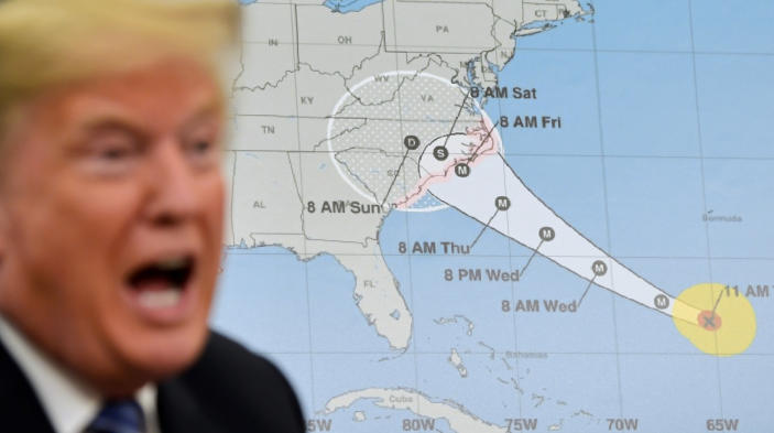 <p>President Donald Trump talks about Hurricane Florence during a briefing in the Oval Office of the White House in Washington, Tuesday, Sept. 11, 2018. (Photo: Susan Walsh/AP) </p>
