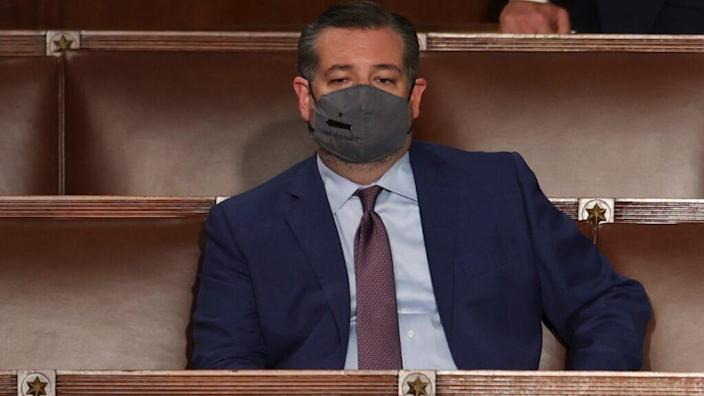 Texas Sen. Ted Cruz listens to President Joe Biden as he delivers an address to a joint session of Congress on the eve of his 100th day in office. (Photo by Jonathan Ernst-Pool/Getty Images)