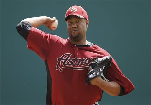 Houston Astros starting pitcher Livan Hernandez (61) throws against the Washington Nationals in the first inning of a spring training baseball game in Viera, Fla., Thursday, March 8, 2012. (AP Photo/Paul Sancya)