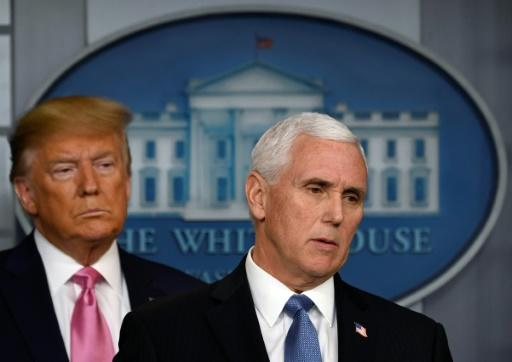 US President Donald Trump (L) has made US Vice President Mike Pence his pointman on dealing with the coronavirus epidemic