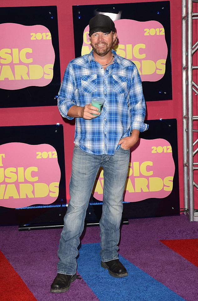 "Toby Keith traded in his ""Red Solo Cup"" for just a simple clear plastic one, but he still went with his signature black ball cap and and plaid shirt. The singer is up for two awards: Video of the Year and Male Video of the Year for his party anthem."