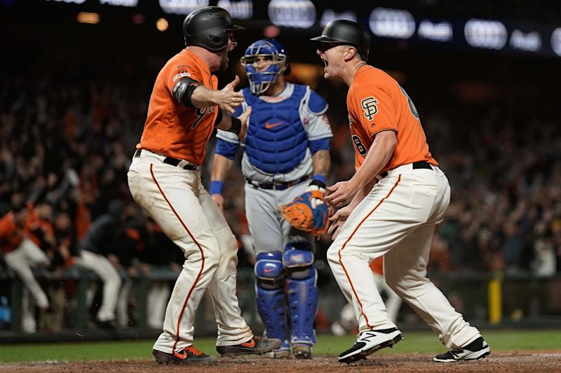 Jul 19, 2019; San Francisco, CA, USA; San Francisco Giants left fielder Alex Dickerson (8) celebrates with catcher Stephen Vogt (21) after scoring the winning run against the New York Mets at Oracle Park. Mandatory Credit: Stan Szeto-USA TODAY Sports