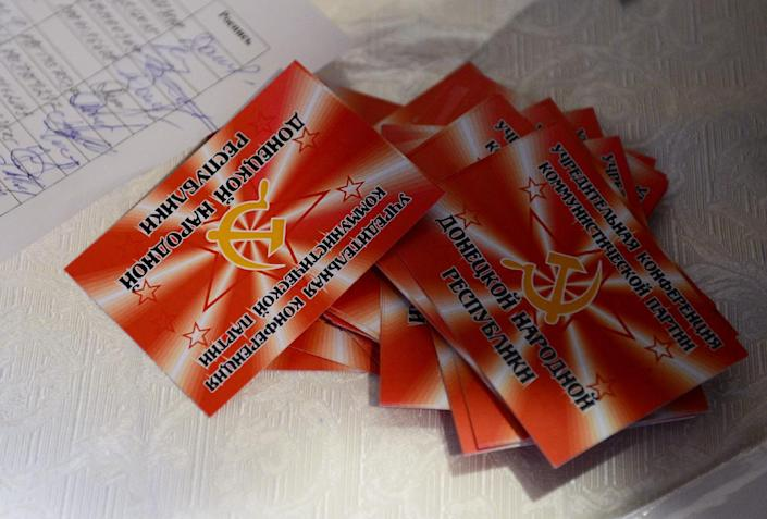 A pile of membership cards are seen prior to the start of the first meeting of the Communist Party of the self-proclaimed Donetsk People's Republic (DPR) in Donetsk, eastern Ukraine, on October 8, 2014 (AFP Photo/John Macdougall)